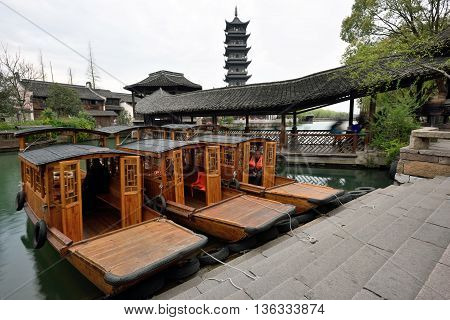 WUZHEN CHINA - MARCH 24: Traditional Chinese boats on March 24 2016 in Wuzhen China. Wuzhen is a historic scenic town located in northern Zhejiang Province China