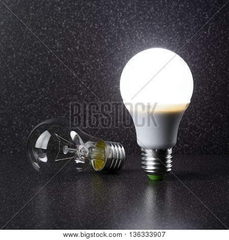 Led Bulb Is Lying Next To Incandescent Lamp
