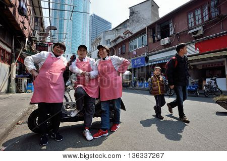 SHANGHAI, CHINA - MARCH 26: Unidentified Chinese people on March 26, 2016 in Shanghai, China. Shanghai is the largest Chinese city by population.