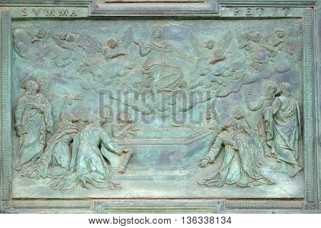 PISA, ITALY - JUNE 06, 2015: The Assumption of the Virgin Mary, panel from Giambologna's school, central portal of the Cathedral St. Mary of the Assumption in Pisa, Italy on June 06, 2015