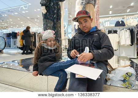 NEW YORK - CIRCA MARCH 2016: children inside of Times Square H&M store. H & M Hennes & Mauritz AB is a Swedish multinational retail-clothing company, known for its fast-fashion clothing.