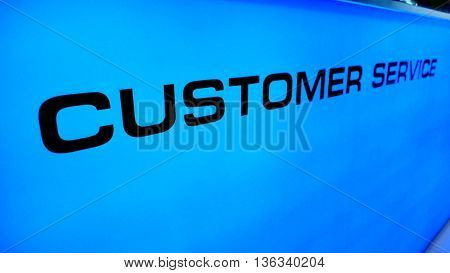 Customer Service Background photo macro and perspective at counter acrylic blue color
