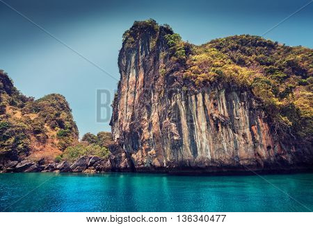 Rocky tropical island in a blue clear sea. Thailand