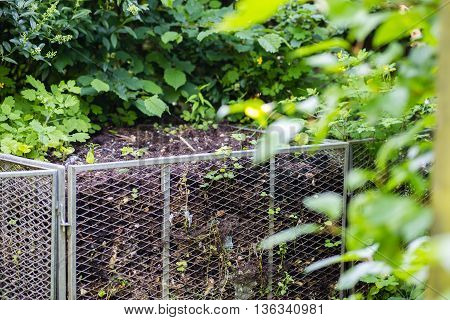 Compost bin in the garden at summer