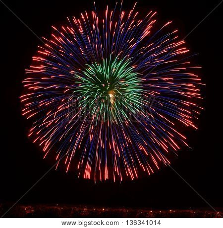 Colourful fireworks isolated in dark background close up with the place for text, Malta fireworks festival, 4 of July, Independence day, New Year, explode. Maltese shell
