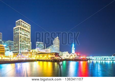 modern office buildings near water at night in san francisco