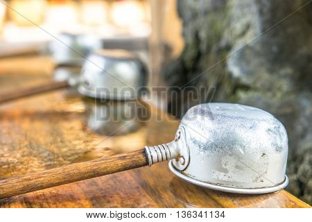 religion dipper with wood handle in tokyo temple