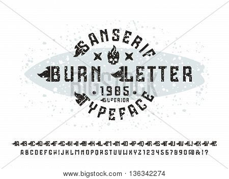 Sanserif font with flame initial letter and spray texture. Typeface design for t-shirt. Black font on light background