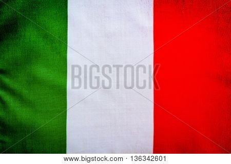 Closeup photo of a Italian flag, abstract grunge background, patriotic wallpaper