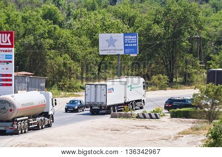 Trucks With Different Cargos Go Out Of Town For A Bypass Road