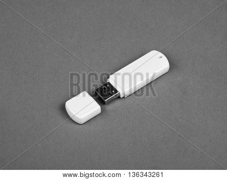 White usb flash drive on gray background.