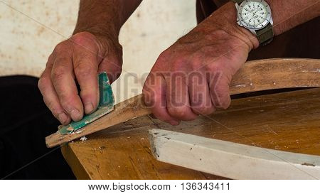 hands of a carpenter working hard on his latest creation