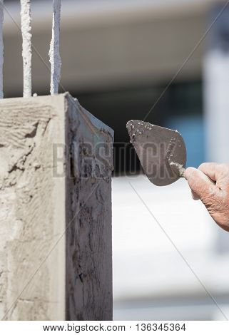 Worker Use Trowel Plastering The Poles
