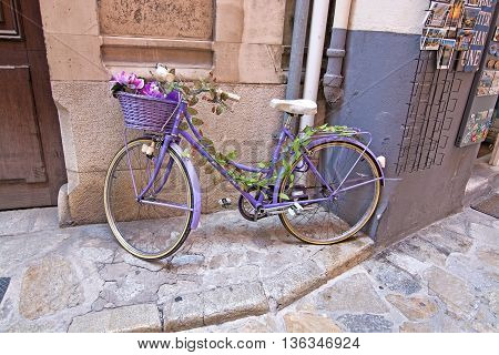 Purple Painted Bicycle With Basket