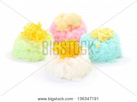 Multiple color of sticky rice with egg custard on white floor.