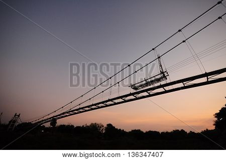 sunrise and bridge in the moring silhouette