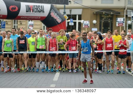 VILNIUS LITHUANIA - SEPTEMBER 14: Runners on start of 11th Danske Bank Vilnius Marathon on 14 September 2014 in Vilnius Lithuania. Vilnius Marathon became a member of AIMS in 2007.