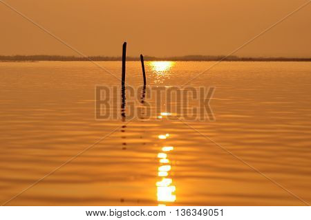 the sunrise reflex on water in the moring