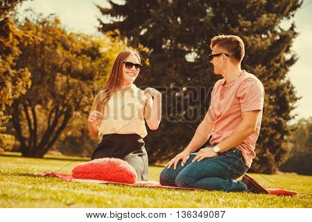 Love romance leisure relax valentines concept. Young couple on picnic. Girlfriend and boyfriend show affection in park.