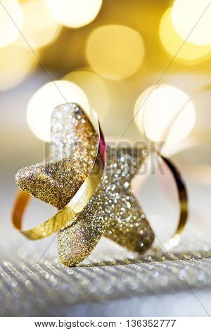 Christmas Star And Glitter On Unfocused Background