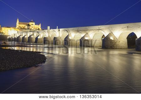 Cordoba - Spain - June 10, 2016 : Roman Bridge On Guadalquivir River And The Great Mosque At Twiligh