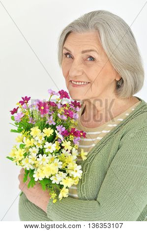 Portrait of a senior woman with blooming flowers