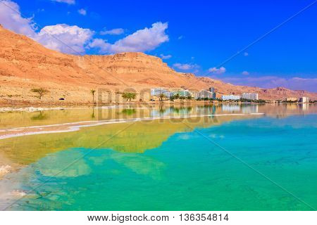 Emerald water of the Dead Sea. The shoaled Dead Sea at coast of Israel