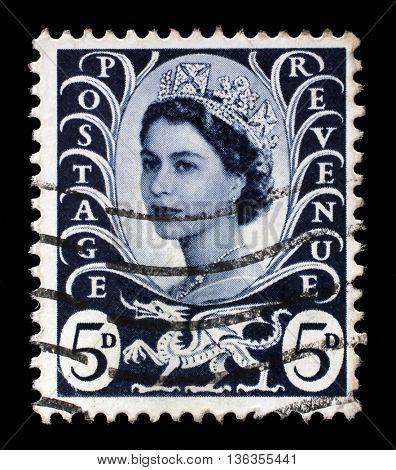 ZAGREB, CROATIA - SEPTEMBER 18: A Welsh Used Postage Stamp showing Portrait of Queen Elizabeth 2nd, circa 1958 to 1969, on September 18, 2014, Zagreb, Croatia