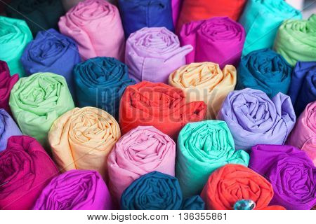 Colorful fabric roll. fabric Industry popular in many countries. You Can use this fabric background for your fabric theme and concept design