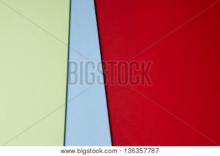 Colored cardboards background in red blue green tone. Copy space. Horizontal
