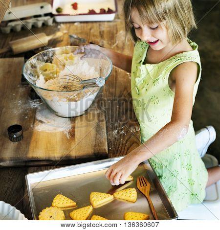 Little Girl Baking Cookies Concept
