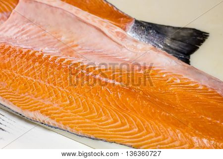 Fish meat without bones. Piece of raw fish. Seafood rich in minerals. Salmon meat for festive dish.