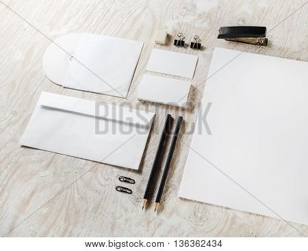 Blank template for branding identity. Blank stationery set and on wooden table background. Responsive design template.