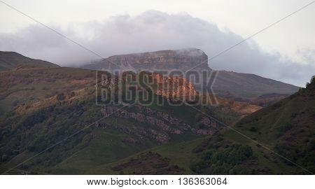 Summer Landscape Mountain Range Shrouded in a Cloud of Fog.