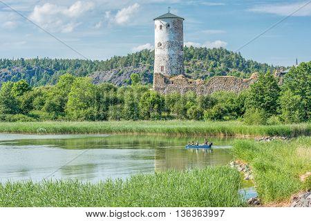 STEGEBORG, SWEDEN - JUNE 25: The bay of Slatbaken and Stegeborg Castle on June 25,2016 in Stegeborg during midsummer in Sweden. Stegeborg is a historic medieval royal castle.