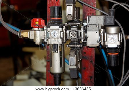 valves for the control and supply of fluids of different machines