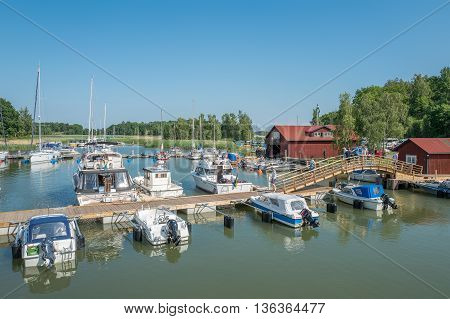 STEGEBORG, SWEDEN - JUNE 25: Leisure boat marina in the bay of Slatbaken  in Stegeborg during midsummer in Sweden. Midsummer is one of the major holidays in Sweden.