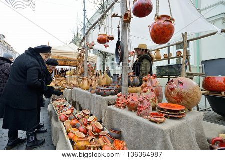 VILNIUS, LITHUANIA - MARCH 7: Unidentified people trade typical lithuanian clay pots in annual traditional crafts fair - Kaziuko fair on Mar 7, 2014 in Vilnius, Lithuania