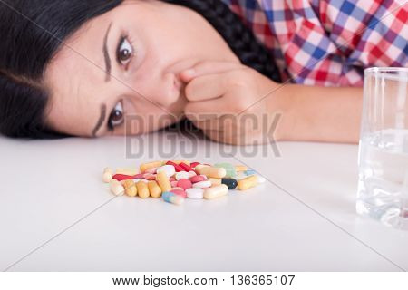 Frustrated Girl Looking At Pills