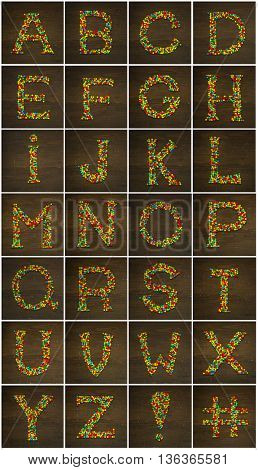 Letter A to Z made with star shape candies on a wooden background making the alphabet