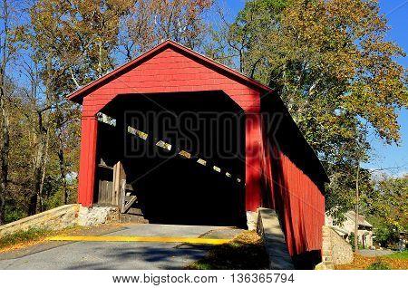 Goodville Pennsylvania - October 19 2015: Single span double Burr arch truss 1859 Pool Forge Covered Bridge over the Conestoga River
