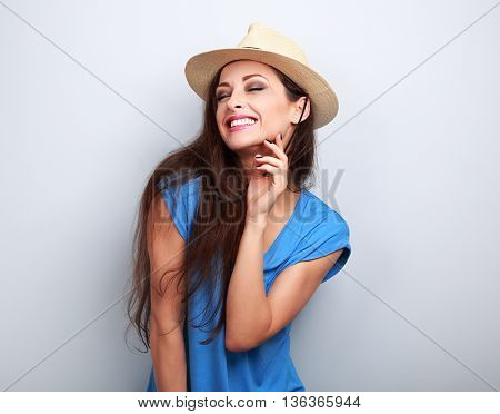 Happy Casual Toothy Laughing Woman In Summer Hat On Blue Background