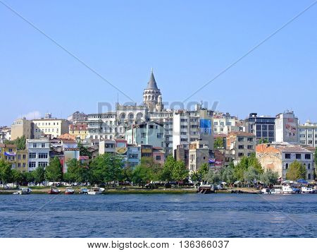 ISTANBUL TURKEY - AUGUST 01: Beyoglu Cityscape in Istanbul on AUGUST 01 2006. Cityscape with Galata Tower From Bosphorus Canal in Istanbul Turkey.