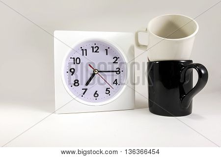 clock with pair cup on isolated backgound