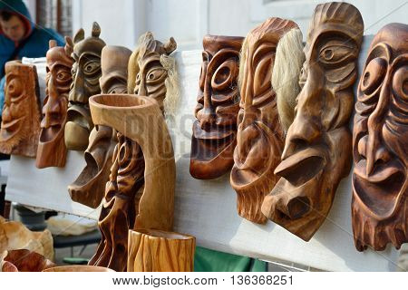 VILNIUS, LITHUANIA - MARCH 8: Unidentified people trade traditional wooden mask in annual traditional crafts fair - Kaziuko fair on Mar 8, 2014 in Vilnius, Lithuania