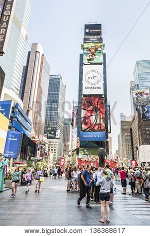 New York, USA - June 18, 2016: Vertical view of busy Times square during the day with advertisements for Samsung and musicals