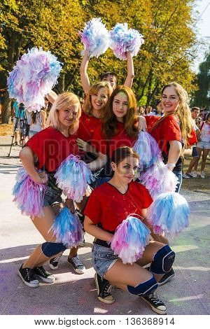 Lviv Ukraine - August 30 2015: Cheerleaders have fun during the festival of color in a city park in Lviv.