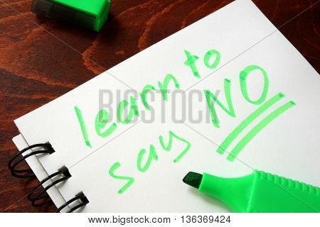 Sign learn to say no in a notebook. Motivation concept.