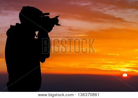 Silhouette of Photographer on Hilltop in beautiful clouds