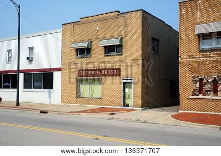JOLIET, ILLINOIS / UNITED STATES - JUNE 30, 2015: A vacant brick building was once the place of business of Tezak Florist in downtown Joliet.